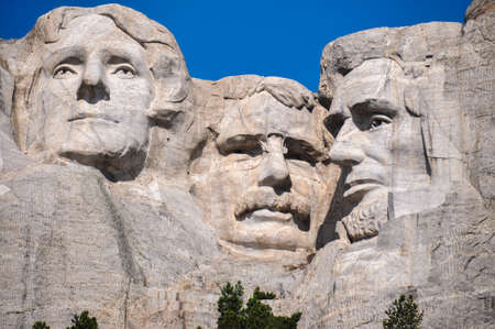 tats: Famous US Presidents on Mount Rushmore National Monument, South Dakota, USA.