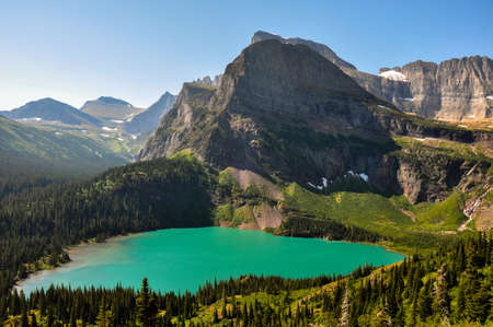tats: Trekking in Grinnel Lake Trail, Glacier National Park, Montana, USA.