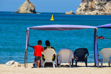 martha: Father & Son at the beach, Rocadero, Colombia. Stock Photo