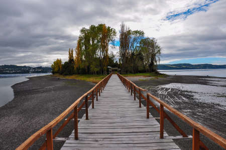 woodcraft: Beautiful small island at the end of a wooden dock, Chiloe Island, Chile.