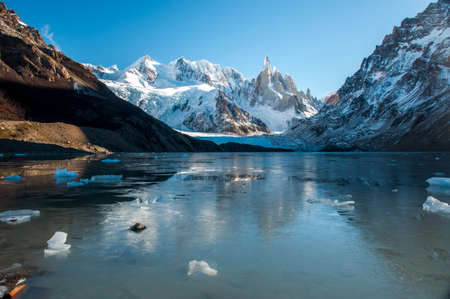 lake argentina: Frozen lake reflection at the Cerro Torre, Fitz Roy, Argentina. Stock Photo