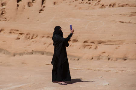 saudi: Saudian Woman taking picture of herself, Saudi Arabia. Stock Photo