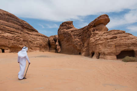 ���archeological site���: Saudian walking in Madain Saleh archeological site, Saudi Arabia. Stock Photo