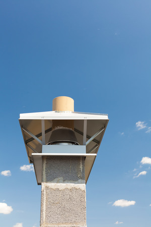 smokestack: New chimney (smokestack) with metal box closeup Stock Photo