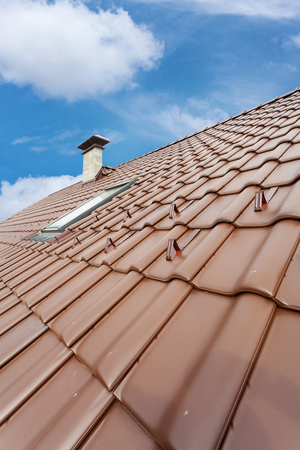 light slate gray: New roof with chimney and skylight, natural red tile and chimney Stock Photo