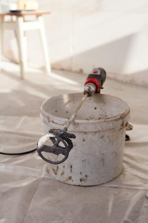 Hand mixer for mortar. Building tools.