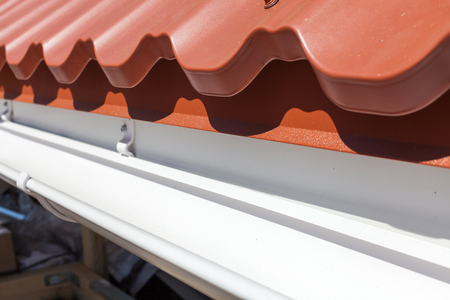 undulate: New red metal tile with white rain gutter