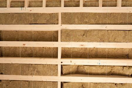 rockwool: Fibreglass insulation installed in the ceiling of a timber house Stock Photo