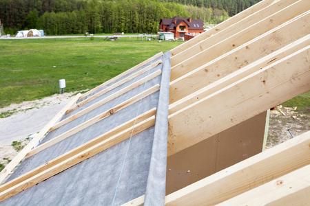 Construction the roof of a new house. Waterproof layering Stock Photo