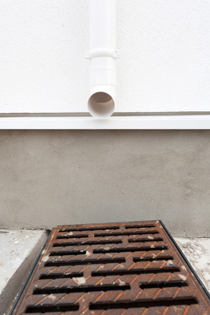 Rain gutter system on house is designed to catch and remove water from the roof and the down spouts are to direct the column of water away from the foundation.