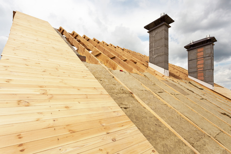 roofing membrane: Roof under construction.Installation mineral wool insulation.