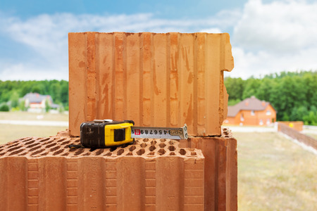 Building roulette on the bricks against blue sky Stock Photo