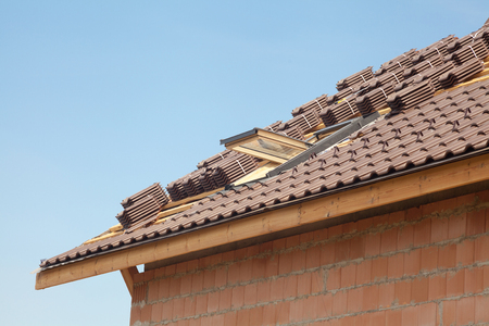 light slate gray: New roof with open skylight, natural red tile against blue sky