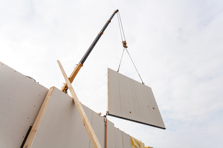 Installing structural Insulated Panels SIP. Building new frame energy-efficient house Stock Photo
