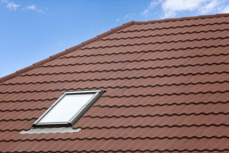 light slate gray: Stone Coated Metal tile Roof with skylight (roof window) Stock Photo