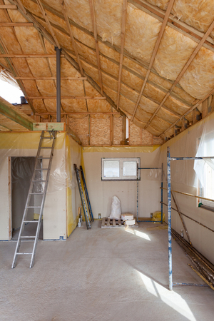 A room at a newly constructed home is sprayed with liquid insulating foam 写真素材