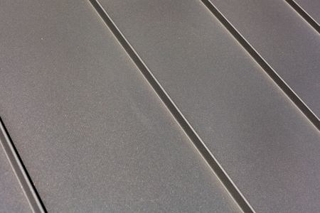 Close up roof sheet metal or corrugated roof of factory building or warehouse.