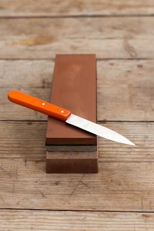 Sharp sharpen knife with grindstone.