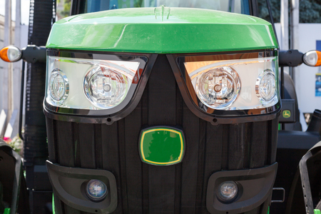 Radiator grille of the  tractor with headlights