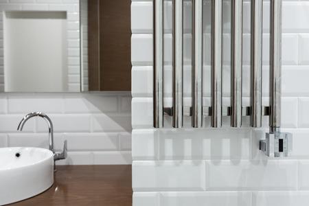 Heated towel rail in the bathroom. Towel warmer in bathroom.