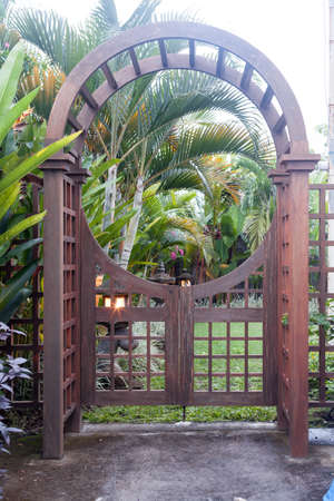 Stock Photo   Wooden Arbor With Close Gate In Garden. Wooden Arched Entrance  To The Backyard