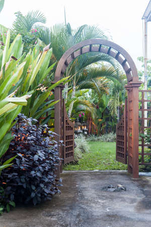 Stock Photo   Wooden Arbor With Gate In Garden. Wooden Arched Entrance To  The Backyard