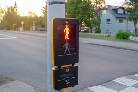 Photo of new modern traffic light with red stop sign pedestrian on the scoreboard