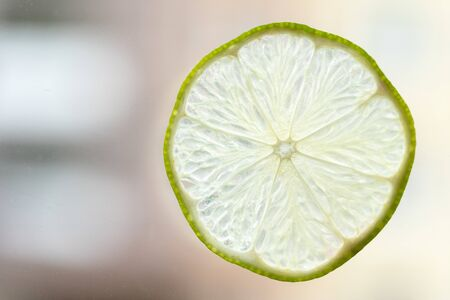 Close up view of delicious citrus, freash, juicy lemon fruit with textured and close up slice on light bright background with copy space