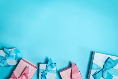 Party time concept! Flat lay and high angle above top view group of wrapped blue and pink gift box with ribbon isolated against shine background with copy or empty space for text