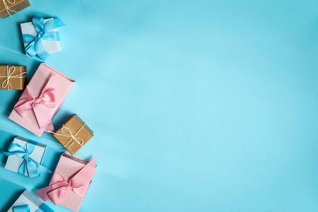 Happy birthday party! Flat lay and high angle above top view of few pink and blue wrapped gift or present box isolated against pastel background with copy or empty space for advertised text