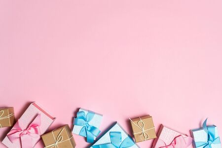 Party time concept! Flat lay and high angle above top view of different presents or wrapped gift box with ribbon isolated on pastel pink background with copy or empty space for text 스톡 콘텐츠