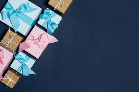 Happy birthday party! Flat lay of group object, different wrapped present gift box isolated against deep dark blue background with copy or empty space for text