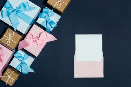 Easy shopping with sale and discount! Flat lay and high angle above top view envelope and group of wrapped present box with ribbon isolated on blue background with copy or empty space for text 스톡 콘텐츠