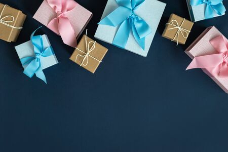 Happy anniversary! Flat lay and high angle above top view of wrapped gift box or presents isolated against dark deep blue background with copy or empty space for text