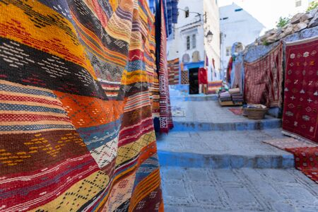 Handmade and ornamental carpet with traditional elements on wall at authentic city market Stockfoto