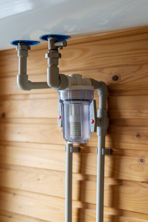 Close up view of water filter for central heating system on wall in boiler room. Modern bathroom at cozy house 写真素材 - 136809710