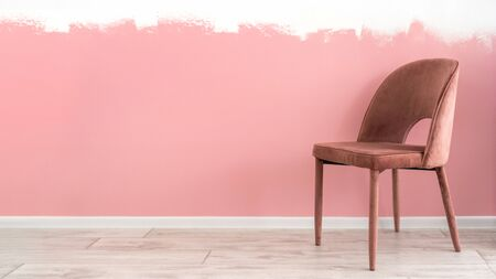 Renovated apartment concept. Painting wall at interior in living room with comfortable, soft and textile chair on floor
