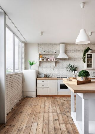 Kitchen with breakfast on dining table, fridge, cooking hood over gas stove appliance, built in oven equipment, kitchenware supplies, green plants on cupboard furniture