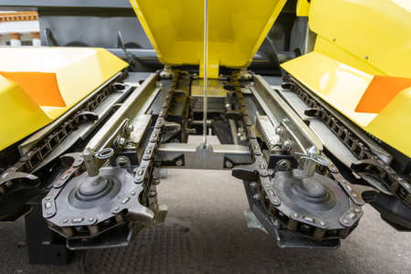 Part of modern combine harvester. Close up shot of rotary system with moving parts at exhibition of agricultural machinery and agro equipment Imagens