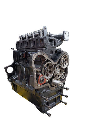 Tractor motor isolated on white copy space background, vertical shot. Engine part of harvester combine or other agricultural machinery. Farm equipment repair and maintenance concept Imagens