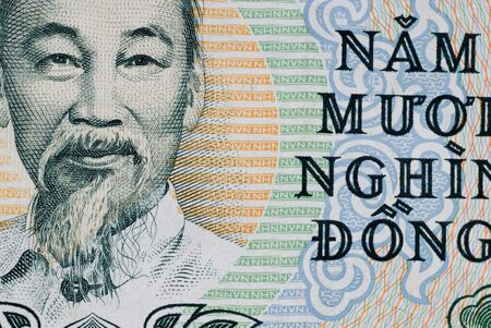 dong: Portion of a Vietnamese 50000 dong note.