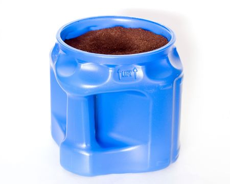 coffee grounds: A blue container full of coffee grounds.