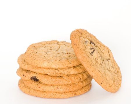 A stack of oatmeal raisin cookies on a white background.