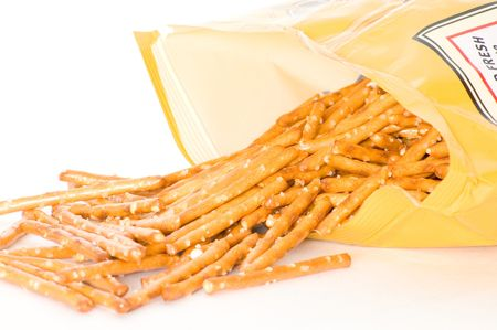pretzel: An open bag of pretzels with contents pouring out.