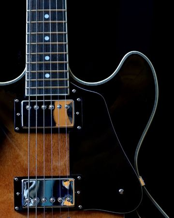 A section of an electric jazz guitar.