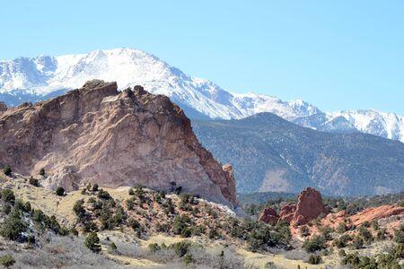 A scenic of Pikes Peak behind Garden Of The Gods in Colorado Springs, Colorado.