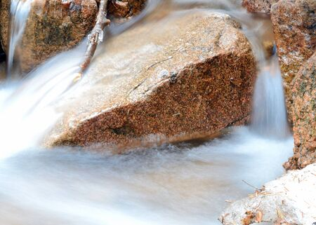 Rocky Mountains flowing stream in late winter. Stock Photo - 9065460
