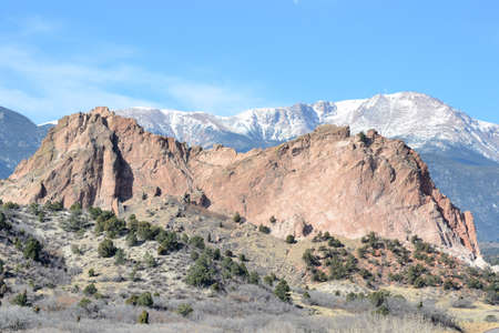 Scenic view of Pikes Peak behind Gray Rock formation of Garden Of The Gods park  by Colorado Springs, Colorado.
