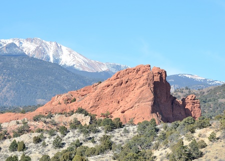 Scenic view of South Gateway Rock rock formation at Garden Of The Gods Park outside of Colorado Springs, Colorado with Pikes Peak behind. photo