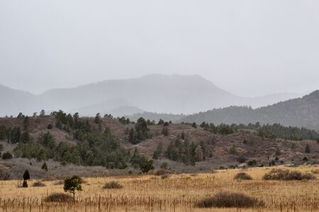front range: A snow storm coming down the rocky moutain front range near Colorado Springs, Colorado. Stock Photo